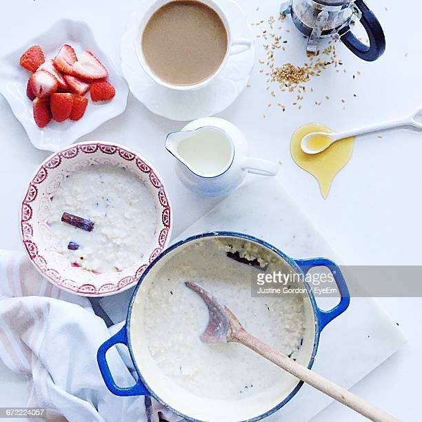 High Angle View Of Porridge By Coffee On Table At Home