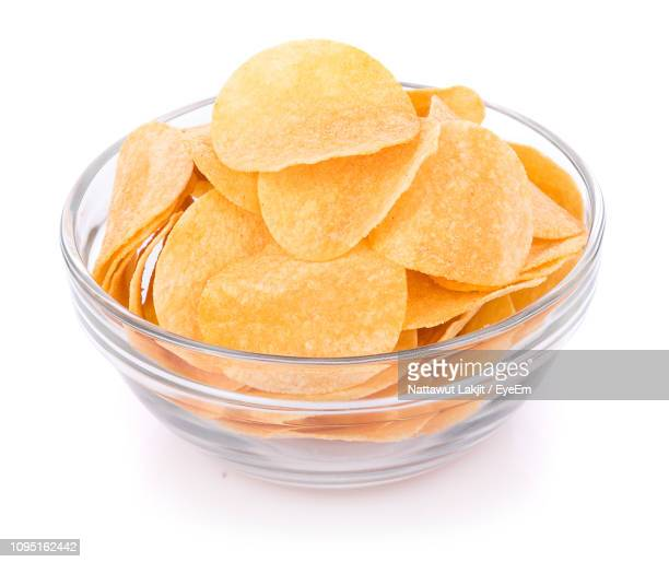 High Angle View Of Potato Chips In Bowl Over White Background