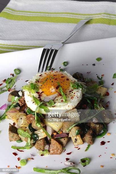 High Angle View Of Potato With Poached Egg Served In Plate