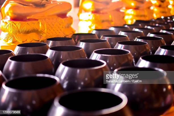high angle view of prayer bowls in temple - gong stock pictures, royalty-free photos & images