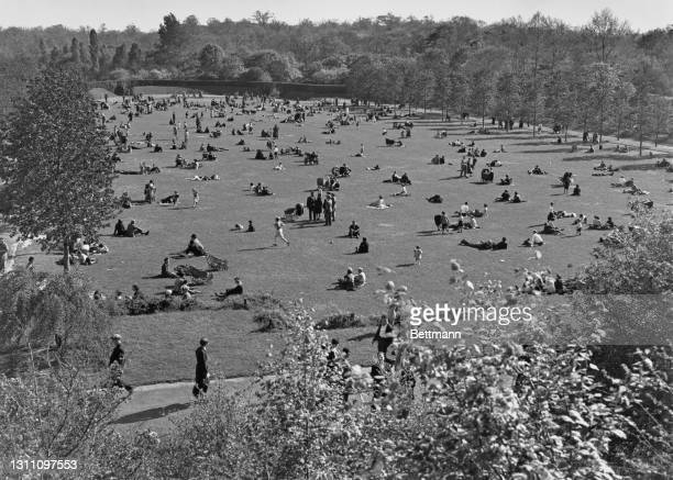 High angle view of Prospect Park as New Yorkers relax on the grass and take in the spring sunshine over the borough of Brooklyn, New York City, New...