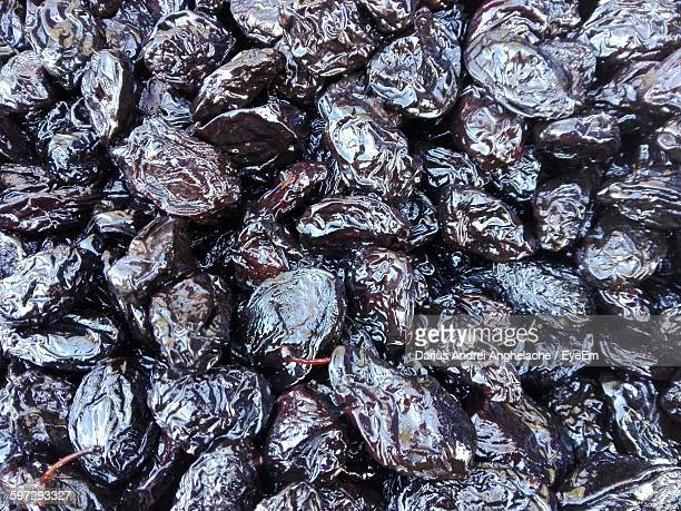high angle view of prunes for sale - dörrpflaume stock-fotos und bilder