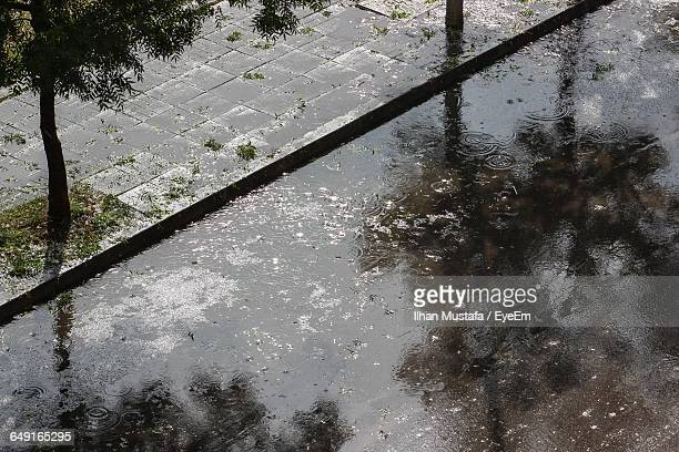 High Angle View Of Puddle At Street During Rainy Season