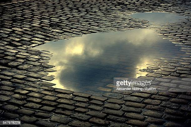 high angle view of puddle on footpath - puddle stock pictures, royalty-free photos & images