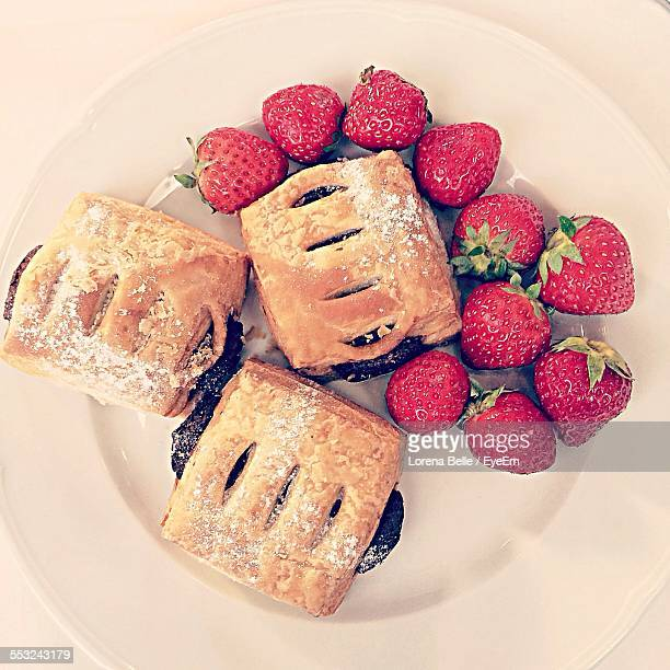 High Angle View Of Puff Pastries With Strawberries In Plate