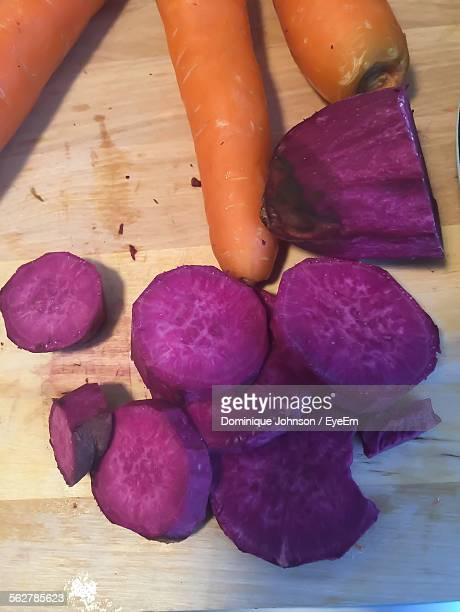 High Angle View Of Purple Potatoes And Carrots On Table