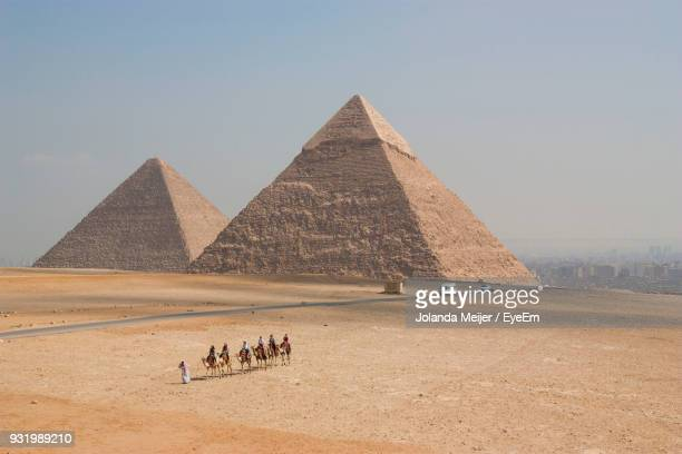 High Angle View Of Pyramid At Desert Against Sky During Sunny Day