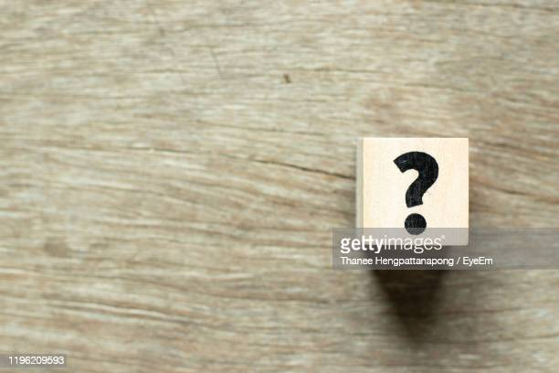high angle view of question mark over toy block on table - q and a stock pictures, royalty-free photos & images