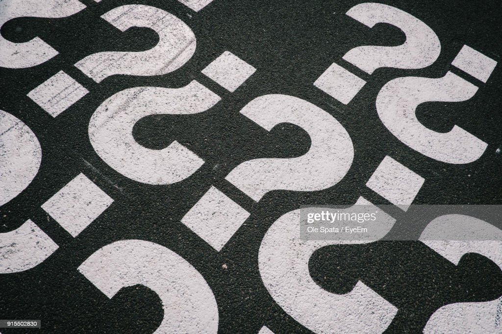 High Angle View Of Question Mark Sign On Road : Stock Photo