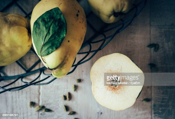 High Angle View Of Quinces On Wooden Table