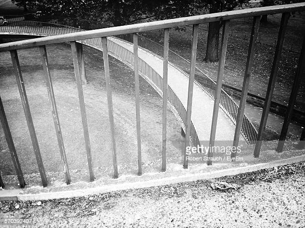 High Angle View Of Railing By Footbridge In Park