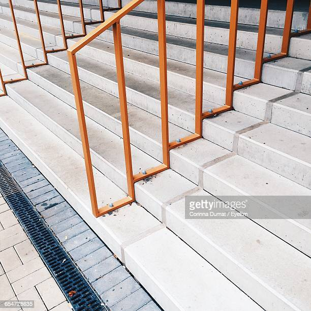 High Angle View Of Railing On Steps By Street