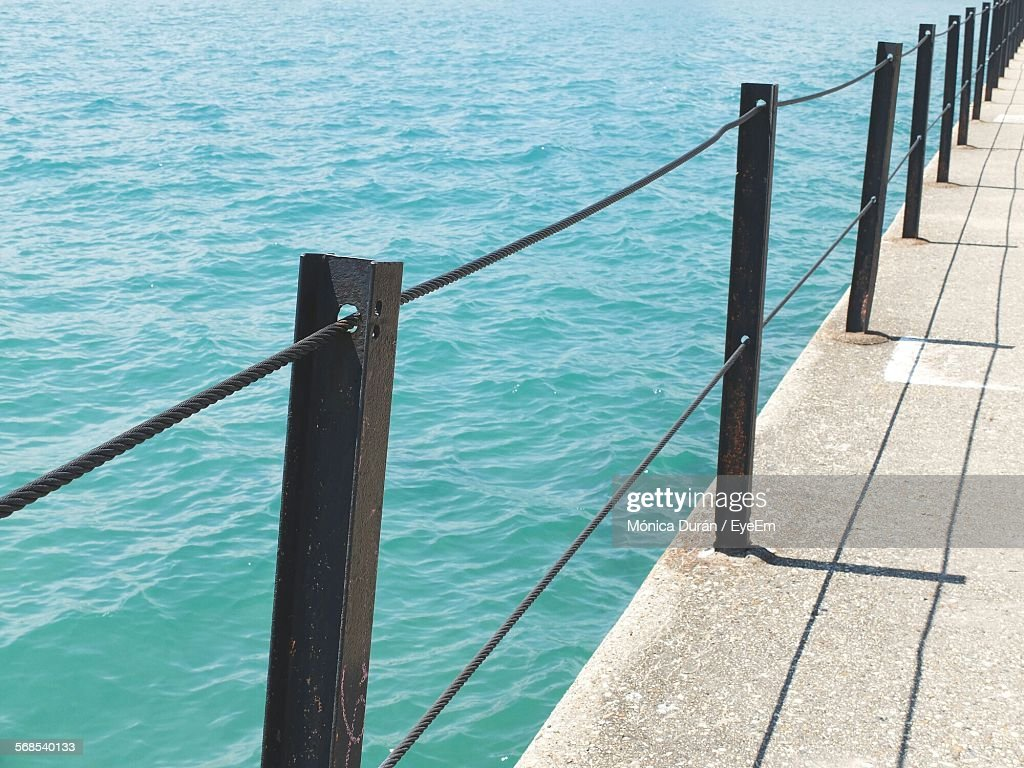 High Angle View Of Railings On Pier At Sea : Stock Photo