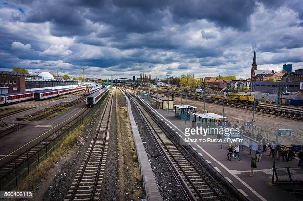 High Angle View Of Railroad Station Against Cloudy Sky
