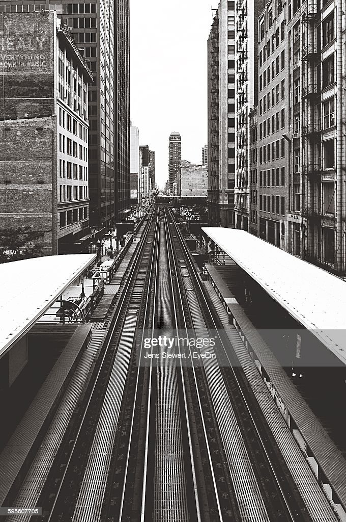 High Angle View Of Railroad Station Amidst Buildings : Stock-Foto