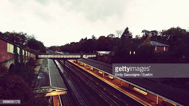 high angle view of railroad station at dusk - weybridge stock photos and pictures