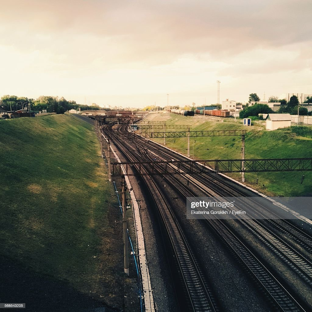 High Angle View Of Railroad Track Amidst Hill Against Sky : Stock Photo