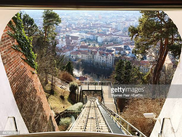 high angle view of railroad track seen through train in city - graz stock photos and pictures