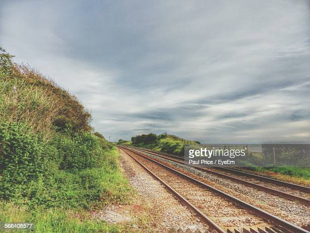 High Angle View Of Railroad Tracks Against Cloudy Sky