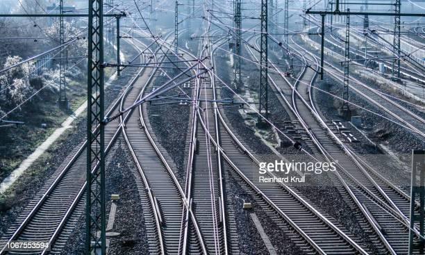 high angle view of railroad tracks - schienenverkehr stock-fotos und bilder
