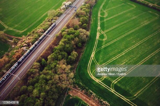 high angle view of railway amidst trees in the country - milton keynes stock pictures, royalty-free photos & images
