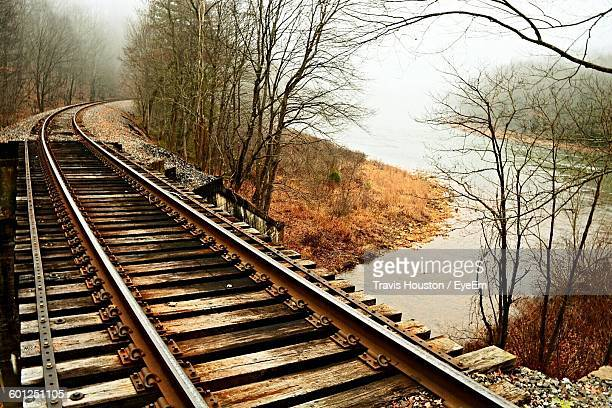 High Angle View Of Railway Bridge Over River In Foggy Weather