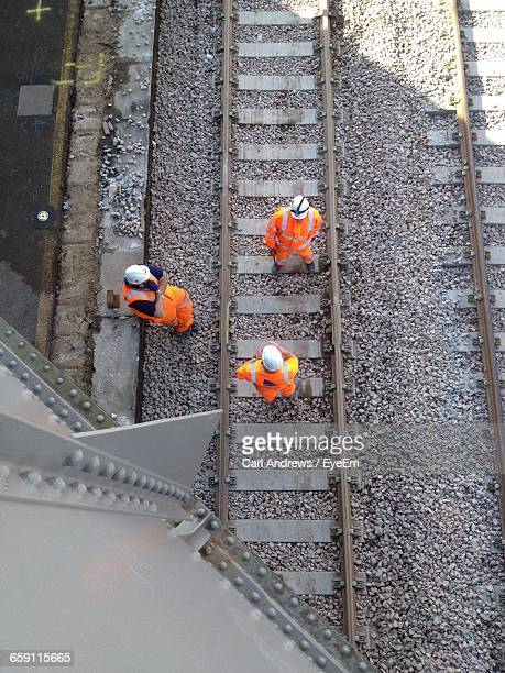 High Angle View Of Railway Workers On Tracks