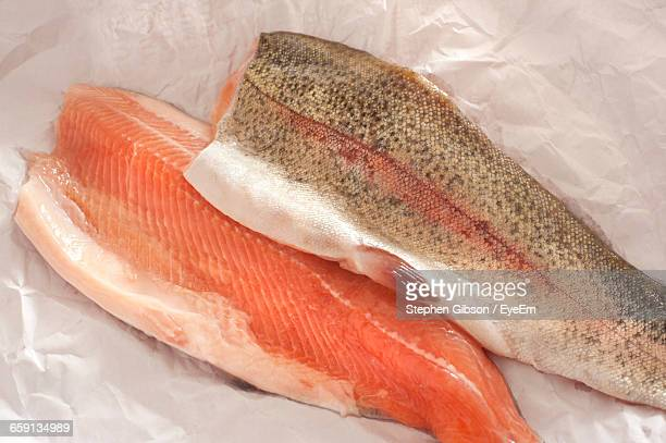 High Angle View Of Rainbow Trout Fillets On Paper