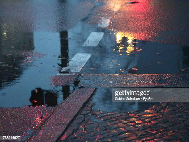 high angle view of raindrops on puddle at street - puddle stock pictures, royalty-free photos & images