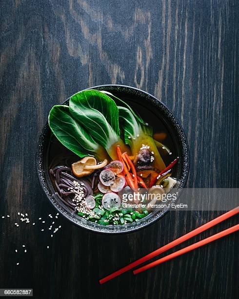 high angle view of ramen noodles in bowl on table - ramen noodles stock pictures, royalty-free photos & images