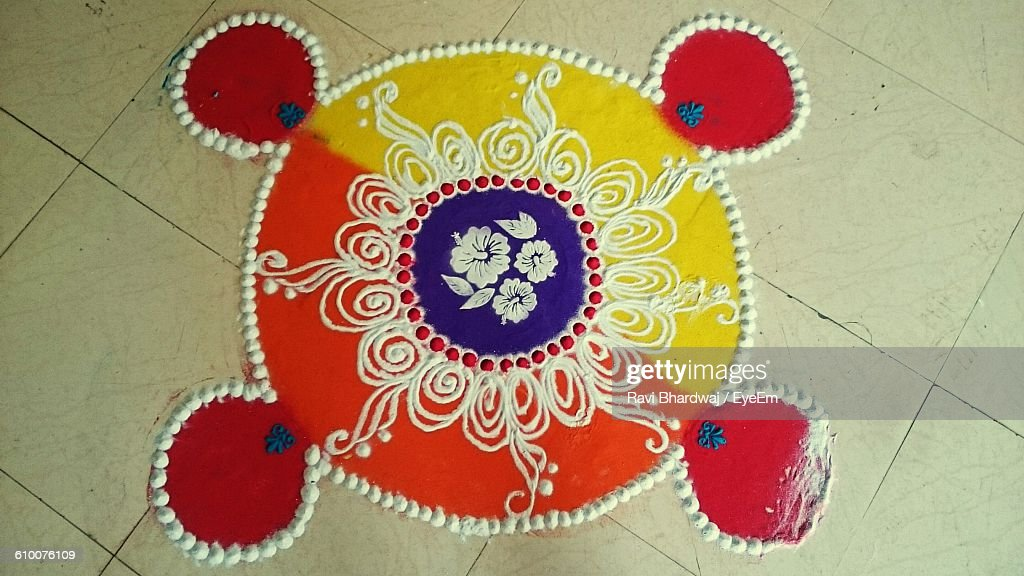 High Angle View Of Rangoli On Floor : Stock Photo