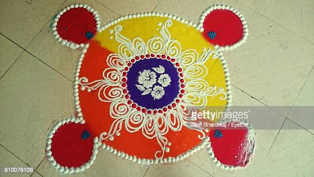 High Angle View Of Rangoli On Floor