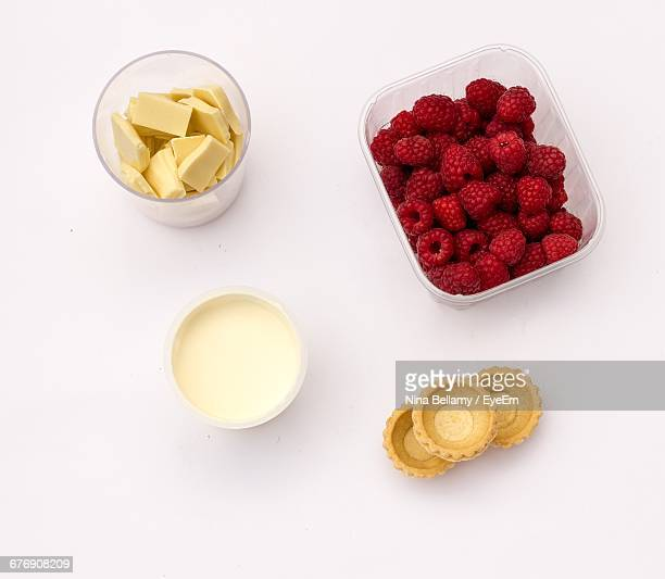High Angle View Of Raspberry By Chocolate And Cream On White Background