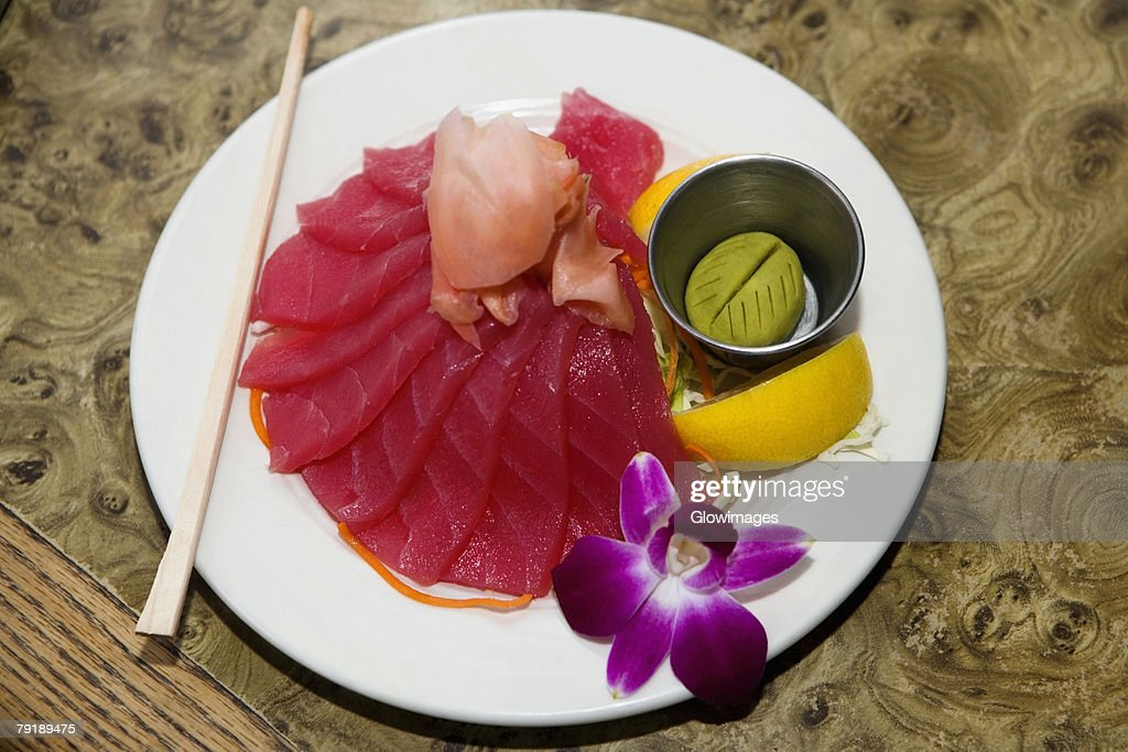 High angle view of raw fish slices in a plate : Stock Photo