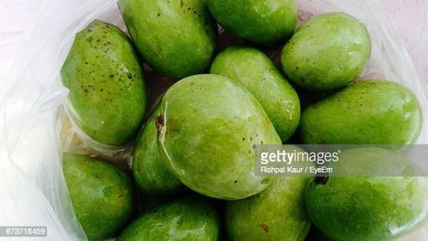 High Angle View Of Raw Mangoes In Plastic