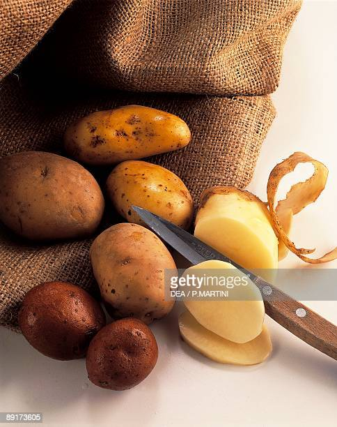 High angle view of raw potatoes with a knife
