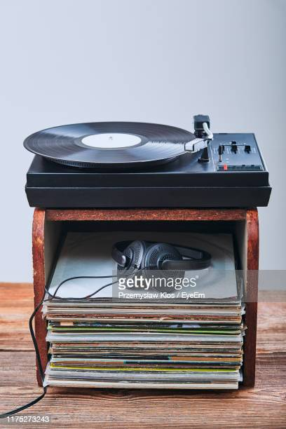high angle view of records and headphones in box with turntable against gray background - deck stock pictures, royalty-free photos & images