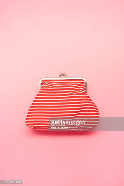 high angle view of red and white striped wallet on pink colored background - clutch bag stock pictures, royalty-free photos & images
