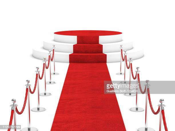 high angle view of red carpet against white background - gala stock-fotos und bilder