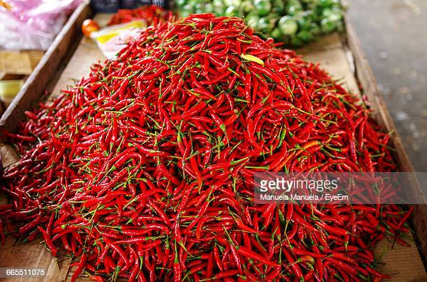 high angle view of red chili peppers at market for sale - red chili pepper stock pictures, royalty-free photos & images