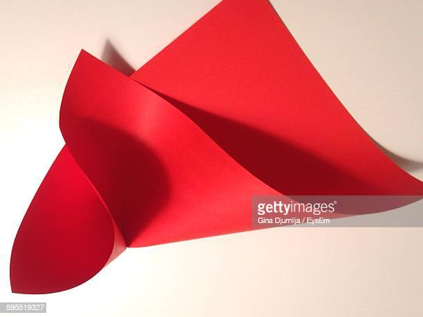 High Angle View Of Red Craft Paper On White Background