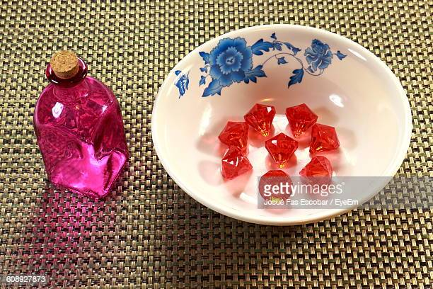 High Angle View Of Red Diamonds In Plate On Table