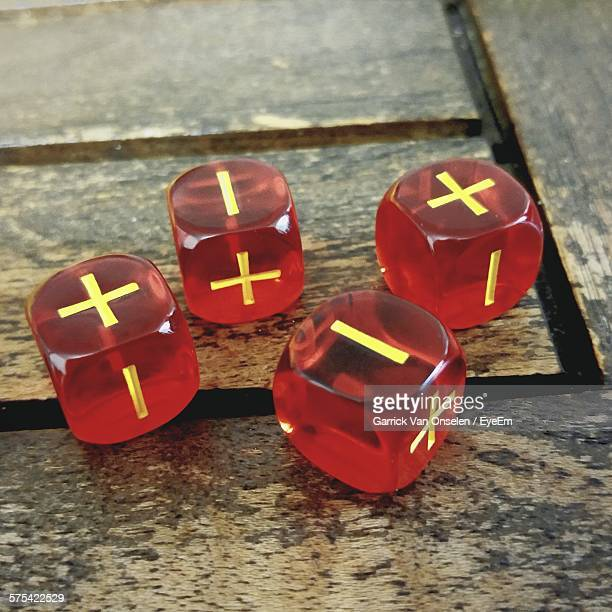 High Angle View Of Red Dices On Wooden Table