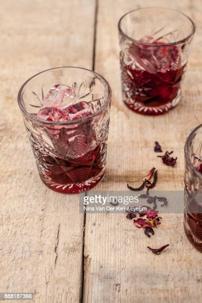High Angle View Of Red Drink In Glass On Table