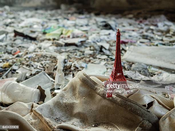 High Angle View Of Red Eiffel Tower Souvenir On Junk