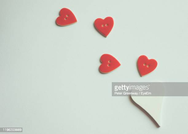 high angle view of red heart shape buttons over white background - bicester village stock pictures, royalty-free photos & images