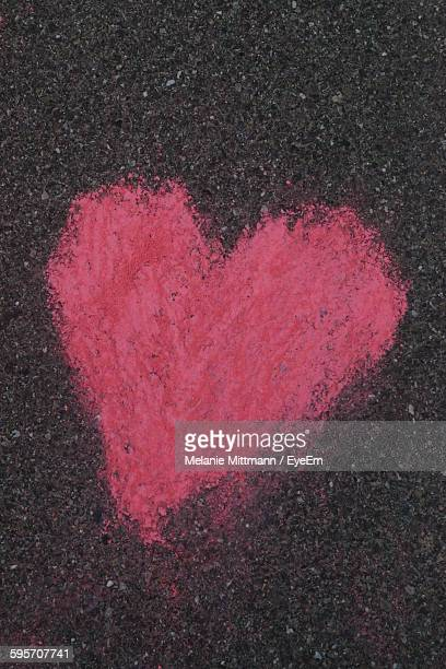 High Angle View Of Red Heart Shape Drawn On Road