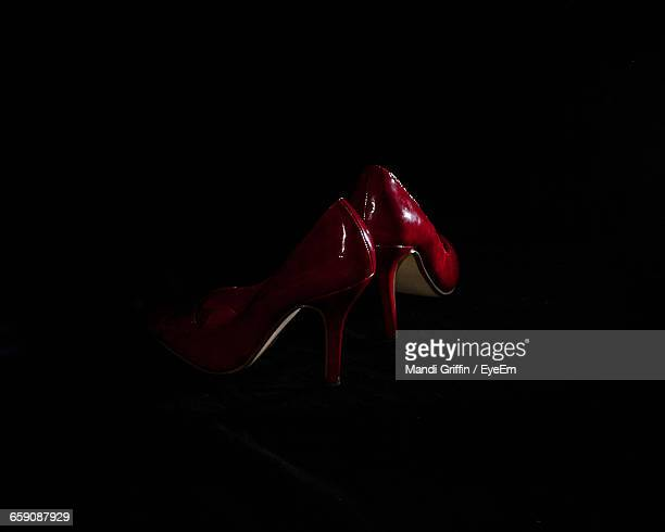 High Angle View Of Red High Heels Against Black Background