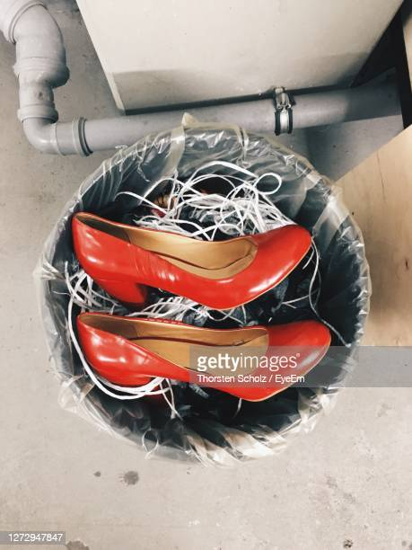 high angle view of red high heels in  dustbin - pump dress shoe stock pictures, royalty-free photos & images