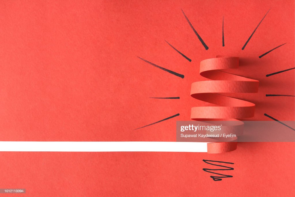 High Angle View Of Red Paper And Drawing On Table : Stock Photo